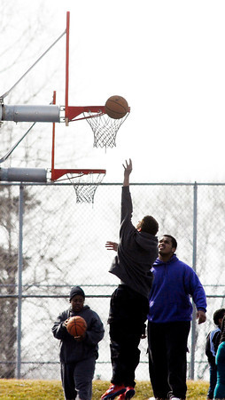John P. Cleary / The Herald Bulletin<br /> Even with temperatures running well below normal for this time of year the basketball courts at Pulaski Park were busy Monday afternoon as area schools were out for spring break and people got out to enjoy the sunshine and the day.