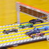 Don Knight / The Herald Bulletin<br /> Cars cross the finish line in the Webelos I division during the Sakima District Cub Scout Pinewood Derby at the Park Place Community Center on Saturday. The top three cars from each division advanced to the championship.