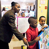 THB photo/John P. Cleary<br /> Schneida Burgess, librarian/teacher at Edgewood Elementary School, lines up students with their posters for a poster parade during the school's Black History Month program Friday.