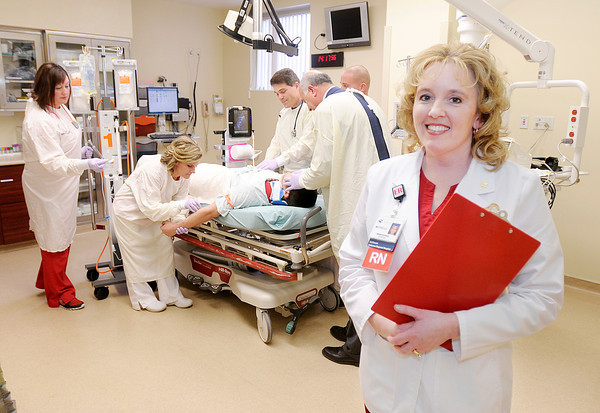 Don Knight / The Herald Bulletin<br /> St. Vincent Trauma Program Manager Michelle Moore stands in  a trauma room as from left, Sharine Todd, Emily Kovacik, Dr. Edward Irick, Matt Irick, Kyle Stewart and Dr. Khalil Wakim, demonstrate how the room is used to treat a trauma patient.