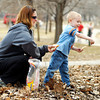 John P. Cleary / The Herald Bulletin<br /> Four year old Levi Ashton loosens up his arm by tossing pieces of bread out to the ducks along Shadyside Lake Tuesday as mom, Amy Alberts, keeps feeding him slices to throw.  With the temperatures getting up to the mid-sixties people got out to enjoy the warm afternoon.