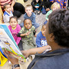 """Don Knight / The Herald Bulletin<br /> Cynthia Boyd reads """"Pete the Cat and his Four Groovey Buttons"""" to her students at Head Start in Anderson on Wednesday. Head Start moved into their new location at 812 West 13th Street in December."""