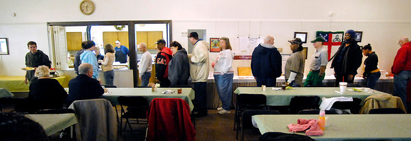 THB photo/John P. Cleary<br /> The line gets long at Trinity Episcopal Church for their Midweek Meal, a free lunch offered 12:30 to 1:30 p.m. every Wednesday to anyone who needs it.<br /> The church has been averaging more than 100 people every week.