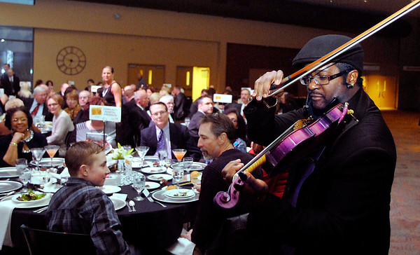 John P. Cleary/The Herald Bulletin<br /> Violinist Colin Matthews, from Shelbyville, provided live dinner music for the guests attending the annual Madison County Chamber awards gala Thursday evening at Madison Park Church of God.
