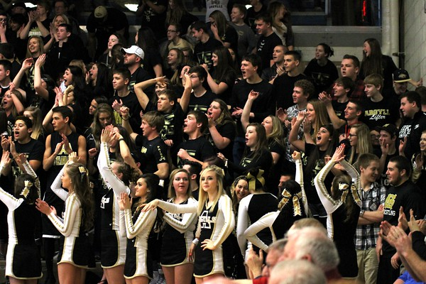 Photo by Chris Martin for The Herald Bulletin<br /> The Madison Grant student section cheers their team after a 3 pointer is made against Oak Hill Saturday morning in a Class 2A Regional game