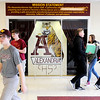 Don Knight | The Herald Bulletin<br /> Students walk past Alexandria-Monroe J.R-Sr. High School's mission statement at the end of the school day on Tuesday. The Alexandria Community Schools Board of Trustees took to voted to change the entryway at the school to increase security.