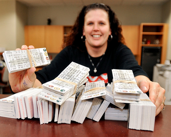 John P. Cleary |  The Herald Bulletin<br /> Frankton High School athletic secretary Katrina Hunter shows off almost 3,000 tickets the school has for the 2A state basketball finals Saturday. Fans started to line up right after school Tuesday even though sales didn't start until that evening. The Frankton Eagles meet the Crawford County Wolfpack for the 2A title at appoximately 12:45 p.m. Saturday.