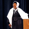 "Don Knight | The Herald Bulletin<br /> Celena Bostic Perry concludes her lecture on Sojourner Truth by performing her famous ""Ain't I a Woman"" speech at Anderson High School on Thursday. The event was presented by ACSC's Multicultural Education Department and was timed to coincide with the end of Black History Month and the beginning of Women's History Month."