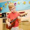 Don Knight | The Herald Bulletin<br /> Isaac Icona plays the ukulele as he represents the Caribbean island of Aruba during Frankton Elementary's World's Fair on Thursday. Read about the fair in Monday's The Herald Bulletin.
