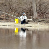 John P. Cleary |  The Herald Bulletin<br /> Fishing on a cold day along the banks of Shadyside Lake this angler casts out into the shallows hoping to get a bite.