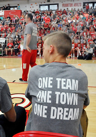 John P. Cleary    The Herald Bulletin<br /> The motto for the school and community is shown on the back of T-shirts that were worn by the team and staff during the school pep rally for the state finals.