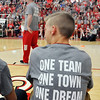 John P. Cleary |  The Herald Bulletin<br /> The motto for the school and community is shown on the back of T-shirts that were worn by the team and staff during the school pep rally for the state finals.