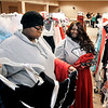 John P. Cleary |  The Herald Bulletin<br /> Madison Willis, 17, and Jametra Wheller, 18, both from Anderson High School, look over the different outfits as they participate in the Anderson Public Library's Project  Fairy Godmother Prom Dress Giveaway Saturday.