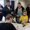 Accompanied by his parents, Adam and Heaven, Pack 202 Cub Scout Aiden Hammers of Anderson registers his car for the Sakima District Pinewood Derby.