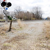 Don Knight | The Herald Bulletin<br /> When County Road 360 West is blocked by a train the only access to the dozen homes is a gravel road owned by CSX but it is sometime blocked by railroad ties or deep snow in the winter.