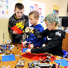 John P. Cleary |  The Herald Bulletin<br /> Elwood Intermediate School 4th graders Hayden Clark, 10, Ayden Belcher, 10, and Caleb McCormick, 10, collaborate their ideas as they work at the Lago Wall in the Maker Space at the school.