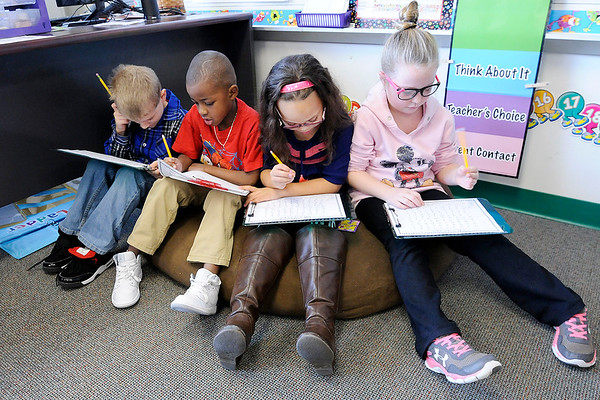 Don Knight | The Herald Bulletin<br /> From left, Nick Foster, Decoriey Tilford, Desireé Posey and Ciana Rogers work on a Martin Luther King Jr. handout on Friday at Erskine Elementary.
