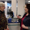 """Kasey Long describes the construction used to create her winning necklace and earrings set titled, """"Gypsy Blues,"""" to Kathy Fehrman during the Art Association of Madison County's 18th Annual Student Exhibition on Sunday at the Mounds Mall."""