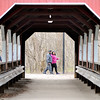 John P. Cleary |  The Herald Bulletin<br /> Framed in the view through the covered bridge at Shadyside Park these folks enjoy a walk along the trails around the lakes at the park.