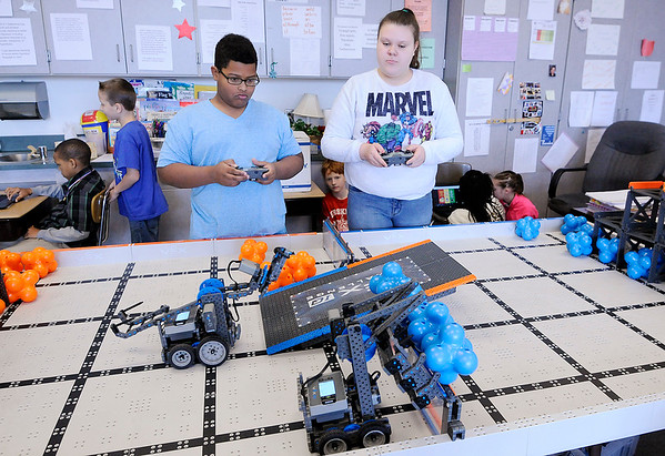 Don Knight | The Herald Bulletin<br /> From left, Symeon Watson and Cadilynn Weaver operate a pair of robots in their 4th grade class at Erskine Elementary on Friday.