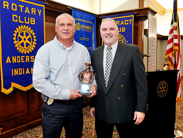John P. Cleary |  The Herald Bulletin<br /> Anderson Police Department Detective Cliff Cole was named Police Officer of the Year by the Madison County Prosecutor's Office by Chief Deputy Prosecutor Steve Koester Tuesday at the Anderson Rotary Club meeting.