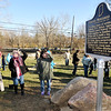 John P. Cleary |  The Herald Bulletin<br /> Pendleton area residents read the Indiana historical marker about the murder of nine Indians in Madison County in 1824 after it was unveiled Wednesday in Pendleton.