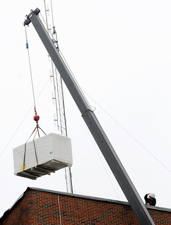 Don Knight | The Herald Bulletin<br /> Supplies for repairing the roof are hoisted to the top of the Madison County Jail on Tuesday. The county council approved a $70,000 request last October from the county's Rainy Day Fund at the request of the county commissioners to pay for the repairs.
