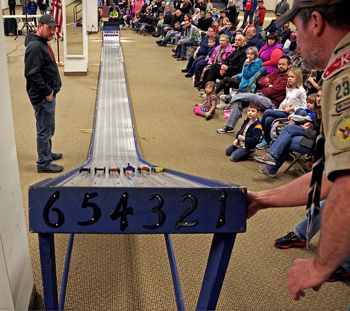 Racecars built by local Cub Scouts rolled down the track past a large group of spectators during the Sakima District Pinewood Derby on Sunday afternoon.