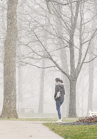 John P. Cleary |  The Herald Bulletin<br /> Anderson University students had a full menu of weather conditions to walk through Thursday on campus, from bright sunshine to snow bursts in a matter of minutes.