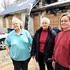 Ken de la Bastide | The Herald Bulletin<br /> Brenda Williams, Clarice Walker and Terri Tupling. Daughters and widow of man who died in fire at 2309 Fowler Street.