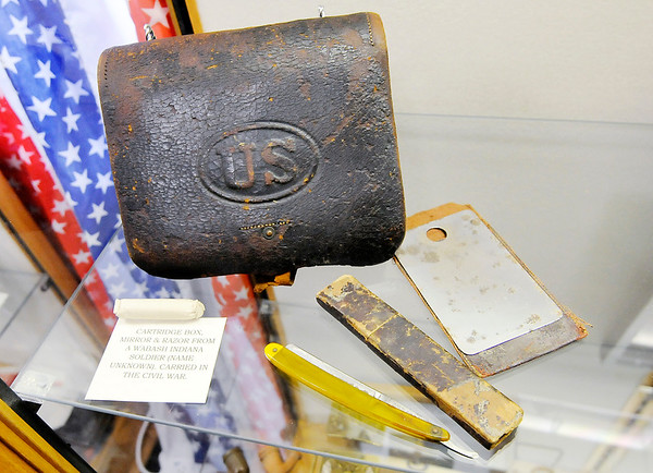 "Don Knight | The Herald Bulletin<br /> A cartridge box, razor and mirror carried by an unknown soldier from Wabash in the Civil War are part of the Madison County Historical Society's new exhibit ""The Civil War:  Soldiers and Stories of Madison County"""