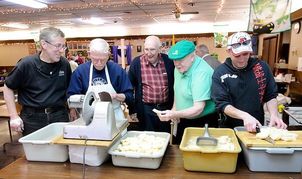 Don Knight   The Herald Bulletin<br /> Volunteers where busy slicing and dicing vegetables at the Knights of Columbus as they prepare Irish Stew for their annual St. Patrick's Day meal on Wednesday. Slicing potatoes from left are, Vice President Joe Lambert, Treasurer Bernie Bruns, President Mike Wulle and Vinnie Cole. The meal is open to the public and stew will be served starting at 11 a.m. until 7 p.m. The cost is $10 for all day access.