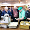 Don Knight | The Herald Bulletin<br /> Volunteers where busy slicing and dicing vegetables at the Knights of Columbus as they prepare Irish Stew for their annual St. Patrick's Day meal on Wednesday. Slicing potatoes from left are, Vice President Joe Lambert, Treasurer Bernie Bruns, President Mike Wulle and Vinnie Cole. The meal is open to the public and stew will be served starting at 11 a.m. until 7 p.m. The cost is $10 for all day access.