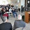 John P. Cleary |  The Herald Bulletin<br /> Jim Schellinger, Indiana Secretary of Commerce, addresses a press conference Friday, along with Tadao Okamura, President of NTK Precision Axel Corp., and Anderson Mayor Thomas Broderick, Jr., that announced a new 300,000 square foot manufacturing facility by NTK to be built in Anderson.