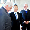 John P. Cleary |  The Herald Bulletin<br /> Anderson Mayor Thomas Broderick, Jr., Tadao Okamura, President of NTK Precision Axel Corp., and Jim Schellinger, Indiana Secretary of Commerce, share a laugh after announcing Friday that NTK will invest $92 million dollars in building a new manufacturing facility in Anderson.