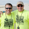 File photo | The Herald Bulletin<br /> During a break in the action Chris Williams poses for a photo with his close friend Matt Rust during the United Way's annual Truck Pull at the Anderson Airport in August.