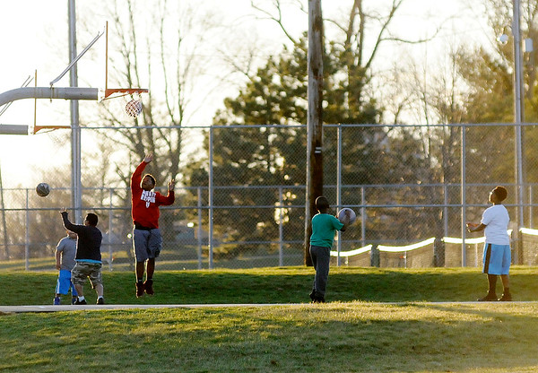 Don Knight | The Herald Bulletin<br /> The sun came out Tuesday afternoon attracting kids to the basketball courts at Pulaski Park. The National Weather Service has issued a wind advisory for today and the forecast includes a chance for snow this weekend.
