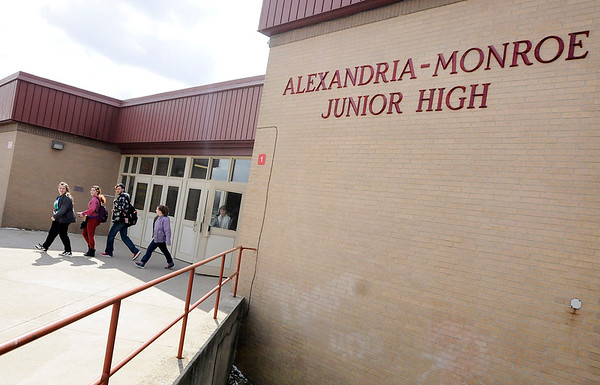 Don Knight | The Herald Bulletin<br /> Students leave at the end of the school day at Alexandria-Monroe J.R-Sr. High School on Tuesday. The Alexandria Community Schools Board of Trustees voted to change the entryway at the school to increase security.