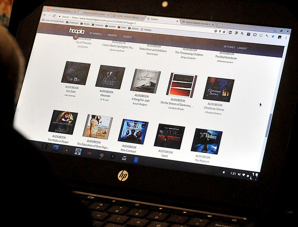 John P. Cleary |  The Herald Bulletin<br /> Highland Middle School students through their new e-cards can access the Anderson Public Library's online resources like these audiobook titles the library has in their catalog.
