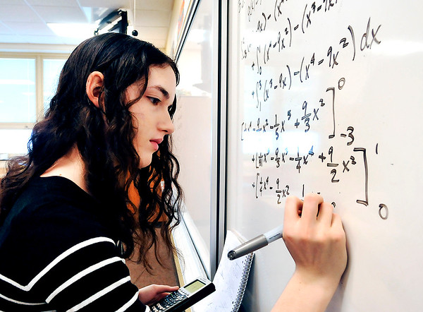 John P. Cleary |  The Herald Bulletin<br /> Lapel High School junior Mya Thomas, 16, works out her calculus problem on the board in Denise Hersberger-Gray's calculus class Tuesday. Students like Thomas would be able to take advantage of advanced online courses under HB 1007.