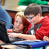 John P. Cleary |  The Herald Bulletin<br /> Highland Middle School sixth-graders Ethan Sullivan and Conner Higgins check out the different resources available to them now through a program with the Anderson Public Library now using the internet and their school assigned Chromebooks.