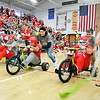 John P. Cleary |  The Herald Bulletin<br /> During Frankton's school pep rally for the basketball team they held the 1st annual Frankton Jr/Sr High School Trike Race.  This race had head coach Brent Brobston, assistant coach Marty Carroll and assistant coach Mark Drake competing against each other with the help of some of the basketball players.