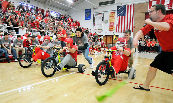 John P. Cleary |  The Herald Bulletin During Frankton's school pep rally for the basketball team they held the 1st annual Frankton Jr/Sr High School Trike Race.  This race had head coach Brent Brobston, assistant coach Marty Carroll and assistant coach Mark Drake competing against each other with the help of some of the basketball players.