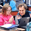 John P. Cleary |  The Herald Bulletin<br /> Highland Middle School sixth-grader Aliyah Brewer reacts with Highland language arts instructional coach Joe Melo as he helps her find what she is looking for from the Anderson Public Library on her school Chromebook as Highland students learn how to use their new e-cards to access the library's resources through a new program.