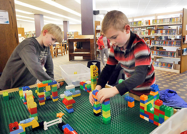 John P. Cleary |  The Herald Bulletin<br /> Joey Massengale, 7, and Aiden Warta, 6, spend much of their time in Anderson Public Library's Children's Department at the Lego inner-active area being creative with the pieces. The library plans a $500,000 remodeling of the area later this year.