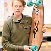 John P. Cleary |  The Herald Bulletin<br /> Recycle & Reuse projects from Cyndee McFarran's 8th-grade Alexandria-Monroe Jr. High School science class. Caleb Bott tells the steps he went through to make this reclaimed wood longboard for his project.