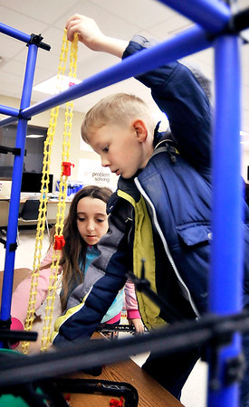 John P. Cleary |  The Herald Bulletin<br /> Joshelynn Simmons, 10, helps Ethan Phillips, 10, as they work on the Chaos Tower as their 4th grade class spent time in the Maker Space at Elwood Intermediate School this past week.