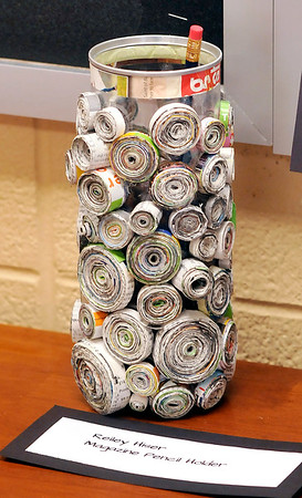 John P. Cleary |  The Herald Bulletin<br /> Recycle & Reuse projects from Cyndee McFarran's 8th-grade Alexandria-Monroe Jr. High School science class. This is Reiley Hiser's Magazine Pencil Holder project.