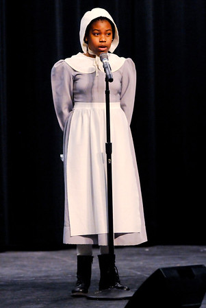Don Knight | The Herald Bulletin<br /> Valley Grove fifth grader Janyah Warren-Burnley portrayed Sojourner Truth as she joined Celena Bostic Perry on stage during her lecture on Sojourner Truth at Anderson High School on Thursday.