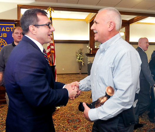 John P. Cleary |  The Herald Bulletin<br /> Anderson Chief of Police Tony Watters congratulates APD Detective Cliff Cole for being named Police Officer of the Year by the Madison County Prosecutor's Office during a luncheon Tuesday at the Anderson Rotary Club meeting.